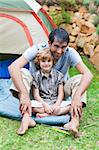 Attractive father and son playing in a tent Stock Photo - Royalty-Free, Artist: 4774344sean, Code: 400-04114607