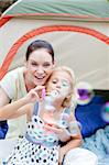 Young mother and daughter playing in tent Stock Photo - Royalty-Free, Artist: 4774344sean, Code: 400-04114614