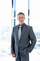 Smiling mature businessman standing in office Stock Photo - Royalty-Freenull, Code: 400-04118214