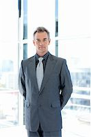 Serious senior businessman standing in office Stock Photo - Royalty-Freenull, Code: 400-04118218