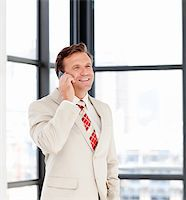 Happy mature businessman talking on phone Stock Photo - Royalty-Freenull, Code: 400-04118256