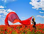 young pretty girl relaxing in the poppy field Stock Photo - Royalty-Free, Artist: doodkoalex, Code: 400-04119735