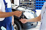 cropped view of mechanic giving car keys to female client Stock Photo - Royalty-Free, Artist: diego_cervo, Code: 400-04124226