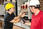 Electricians working on an industrial power distribution center.  Actual electricians and authentic accurate content. Stock Photo - Royalty-Free, Artist: lisafx, Code: 400-04124570