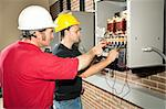 Vocational education student learns how to repair an industrial power distribution center. Stock Photo - Royalty-Free, Artist: lisafx, Code: 400-04124588