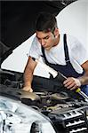 mechanic looking to car engine and holding lamp Stock Photo - Royalty-Free, Artist: diego_cervo, Code: 400-04126650