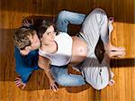 Top view of a young couple seated on the floor waiting for a baby. Stock Photo - Royalty-Free, Artist: AntonPrado, Code: 400-04127376