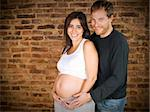 Pregnant young couple smiling at the camera. Stock Photo - Royalty-Free, Artist: AntonPrado, Code: 400-04127377