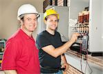 Apprentice electrician and his instructor reading the voltage on a power distribution center. Stock Photo - Royalty-Free, Artist: lisafx                        , Code: 400-04129912