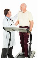 Doctor shaking the hand of a senior man following a fitness test on the treadmill.  Isolated on white. Stock Photo - Royalty-Freenull, Code: 400-04133158