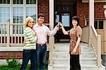 Happy couple getting keys to new house from real estate agent Stock Photo - Royalty-Free, Artist: Elenathewise                  , Code: 400-04133256