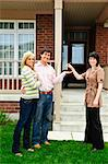 Happy couple getting keys to new house from real estate agent Stock Photo - Royalty-Free, Artist: Elenathewise                  , Code: 400-04133257