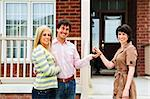 Happy couple getting keys to new house from real estate agent Stock Photo - Royalty-Free, Artist: Elenathewise                  , Code: 400-04133258