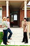 Real estate agent with couple welcoming to new home Stock Photo - Royalty-Free, Artist: Elenathewise                  , Code: 400-04133259