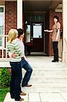 Real estate agent with couple welcoming to new home Stock Photo - Royalty-Free, Artist: Elenathewise                  , Code: 400-04133260