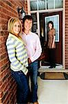 Real estate agent with couple welcoming to new home Stock Photo - Royalty-Free, Artist: Elenathewise                  , Code: 400-04133261
