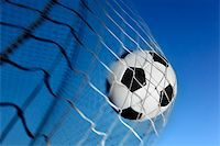 Soccer ball kicked into the back of a goal Stock Photo - Royalty-Freenull, Code: 400-04138651