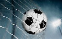 Soccer ball kicked into the back of a goal Stock Photo - Royalty-Freenull, Code: 400-04138654