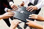 Close-up of people hands holding black leather briefcase simultaneously Stock Photo - Royalty-Free, Artist: pressmaster, Code: 400-04146006
