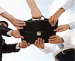 Photo of human hands touching a black briefcase Stock Photo - Royalty-Free, Artist: pressmaster, Code: 400-04146687