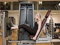 sweaty woman - Girl exercing her legs at a health club Stock Photo - Royalty-Freenull, Code: 400-04148018