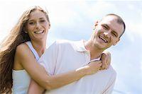 Portrait of happy girl hugging handsome man outside S