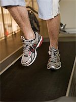 sweaty woman - Man running on a treadmill in a healthclub Stock Photo - Royalty-Free, Artist: gemenacom, Code: 400-04149216