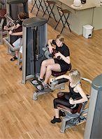 sweaty woman - Boy and a girl using excercise machines in a health canter Stock Photo - Royalty-Freenull, Code: 400-04149219