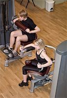 sweaty woman - Boy and a girl using excercise machines in a health canter Stock Photo - Royalty-Free, Artist: gemenacom, Code: 400-04149222