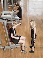 sweaty woman - Girl talking to a young man while he exercise Stock Photo - Royalty-Freenull, Code: 400-04149223