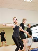sweaty woman - Group of people doing step up with a girl in focus Stock Photo - Royalty-Freenull, Code: 400-04149244
