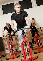 sweaty woman - Group of people having spinning class with a young man in focus Stock Photo - Royalty-Freenull, Code: 400-04149255