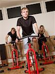 Group of people having spinning class with a young man in focus Stock Photo - Royalty-Free, Artist: gemenacom, Code: 400-04149256