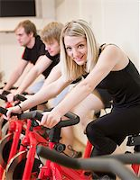 sweaty woman - Group of people having spinning class with a girl in focus Stock Photo - Royalty-Freenull, Code: 400-04149259