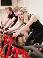 Group of people having spinning class with a girl in focus Stock Photo - Royalty-Free, Artist: gemenacom, Code: 400-04149260