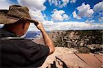 Male hiker looking over the ridge of the Grand Canyon Stock Photo - Royalty-Free, Artist: creatista, Code: 400-04149344