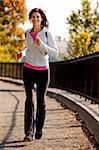 A young woman jogging on a path in a park Stock Photo - Royalty-Free, Artist: Leaf, Code: 400-04149630