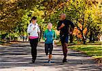 Three young adults jogging in the park Stock Photo - Royalty-Free, Artist: Leaf, Code: 400-04149631
