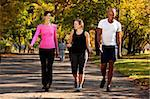 Three people walking in a park, getting some exercise Stock Photo - Royalty-Free, Artist: Leaf, Code: 400-04149632