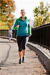 A woman jogging in a park Stock Photo - Royalty-Free, Artist: Leaf, Code: 400-04150705
