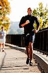 An African American jogging in a park in the morning Stock Photo - Royalty-Free, Artist: Leaf, Code: 400-04150706