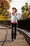 A young woman jogging in the park on a path Stock Photo - Royalty-Free, Artist: Leaf, Code: 400-04150707