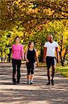 Three people walking in a park, getting some exercise Stock Photo - Royalty-Free, Artist: Leaf, Code: 400-04150708