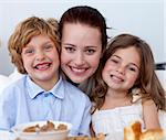 Portrait of children having breakfast in kitchen with their mother Stock Photo - Royalty-Free, Artist: 4774344sean, Code: 400-04151268