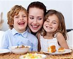 Children having breakfast in kitchen with their mother Stock Photo - Royalty-Free, Artist: 4774344sean, Code: 400-04151271