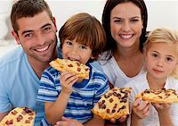 Portrait of happy family eating pizza in living-room all together Stock Photo - Royalty-Freenull, Code: 400-04152232