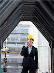 female engineer talking on mobile phone in construction site Stock Photo - Royalty-Free, Artist: diego_cervo, Code: 400-04154152