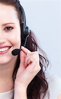 secretary desk - Portrait of smiling attractive woman talking on a headset Stock Photo - Royalty-Freenull, Code: 400-04154725