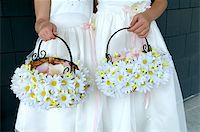 Image of two flower girls holding daisy baskets Stock Photo - Royalty-Freenull, Code: 400-04161968