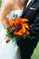 Image of a colorful bouquet being held by a bride and groom Stock Photo - Royalty-Freenull, Code: 400-04161969
